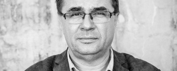 Zdjęcie portretowe dr Rafała Matyi (twarz mężczyzny w okularach).